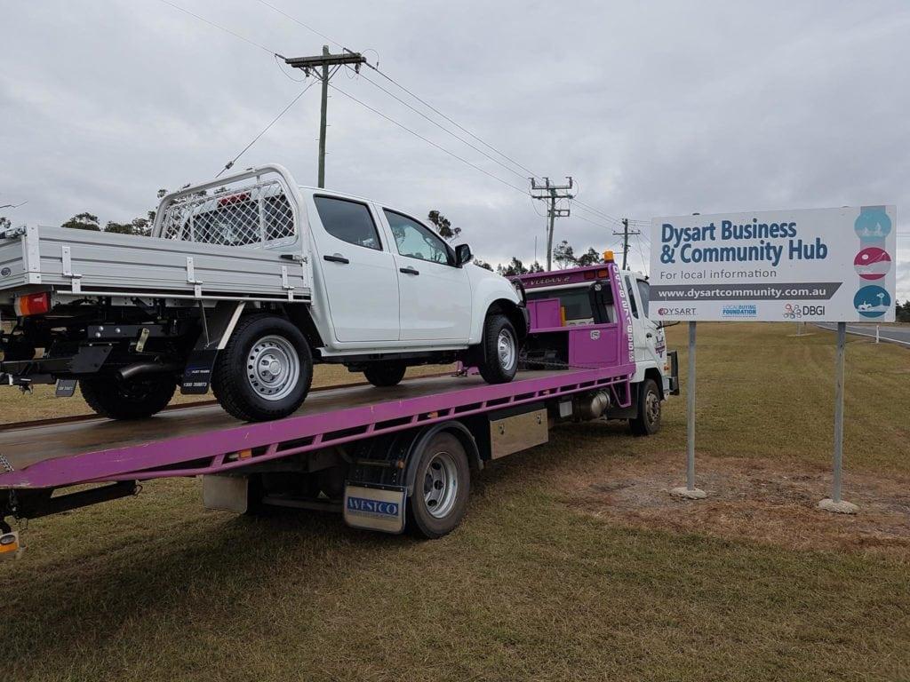 Vulcan transporting new car